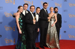 Actors Christian Slater (3L) and Rami Malek (C) and other members of the cast and crew ofMr Robot pose with the award for Best TV Series Drama in the press room at the 73nd annual Golden Globe Awards, January 10, 2016, at the Beverly Hilton Hotel in Beverly Hills, California. AFP PHOTO / FREDERIC J. BROWN / AFP / FREDERIC J BROWN (Photo credit should read FREDERIC J BROWN/AFP/Getty Images)